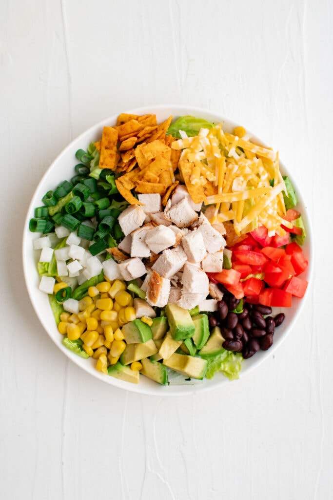 ingredients for bbq chicken salad in a bowl