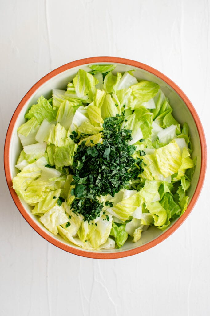 lettuce and cilantro in a large bowl