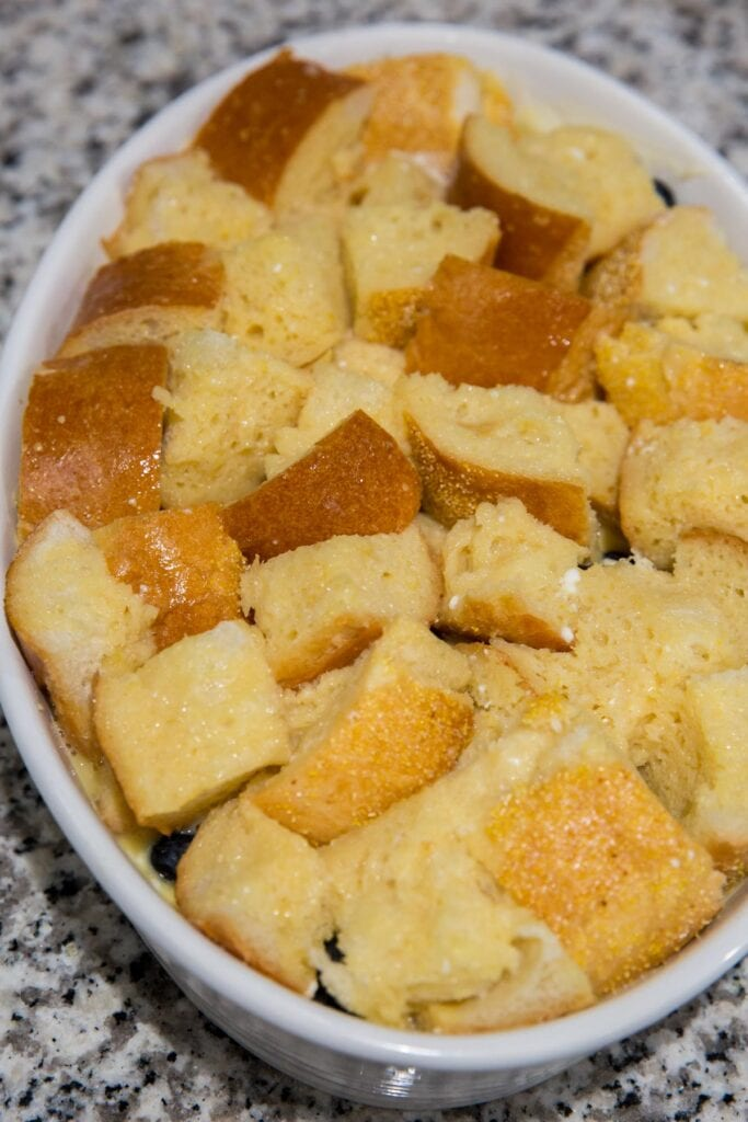 french bread cubes in a baking dish