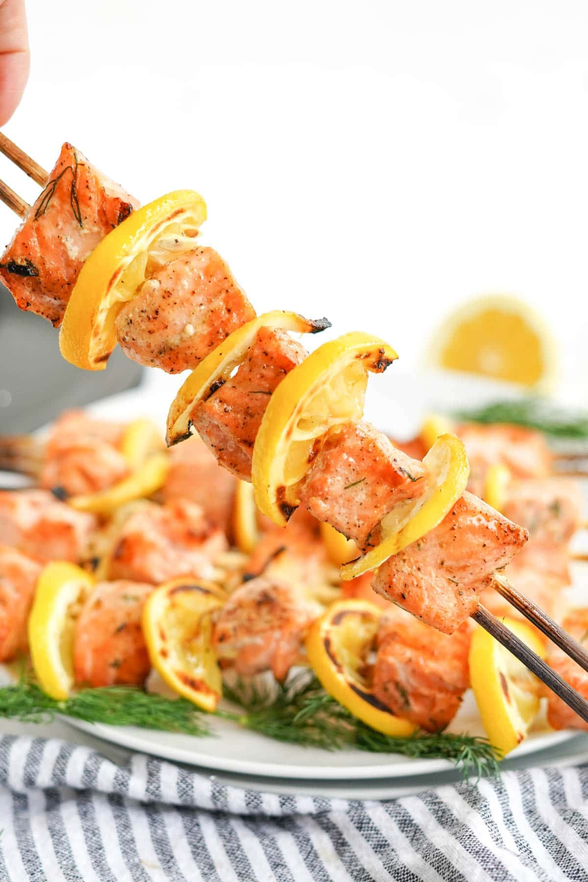 grilled salmon kabobs on a white plate