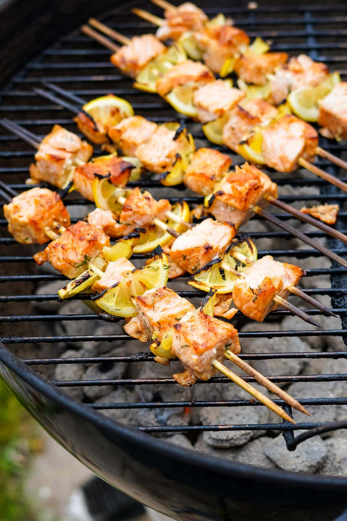 salmon kabobs with lemon on a grill