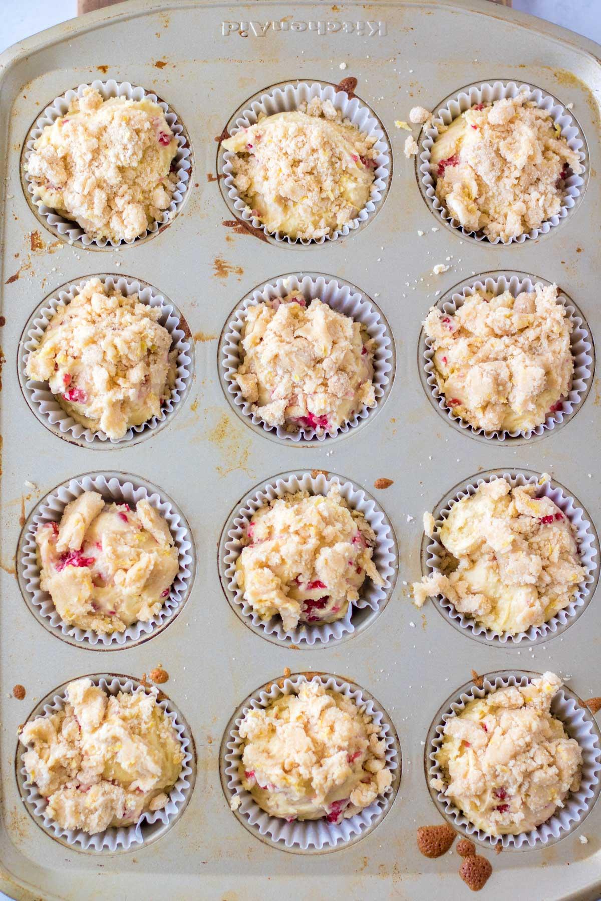 raspberry muffin batter in a muffin pan