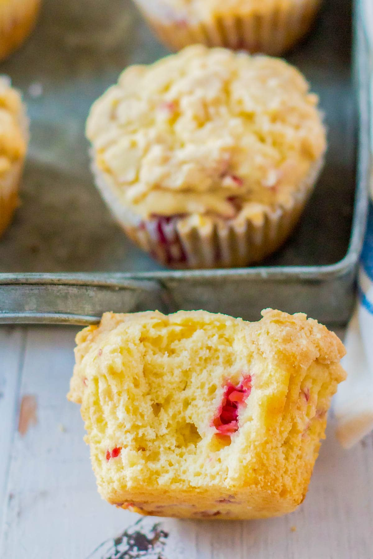 rasberry muffins with a bite taken out