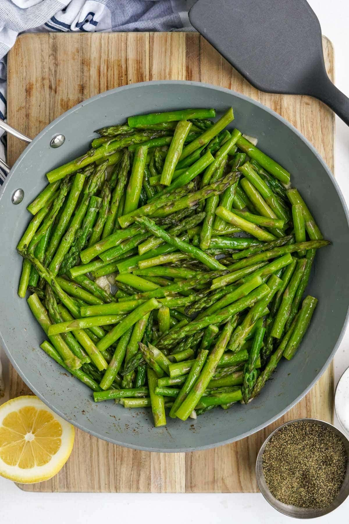 large skillet with sauteed asparagus