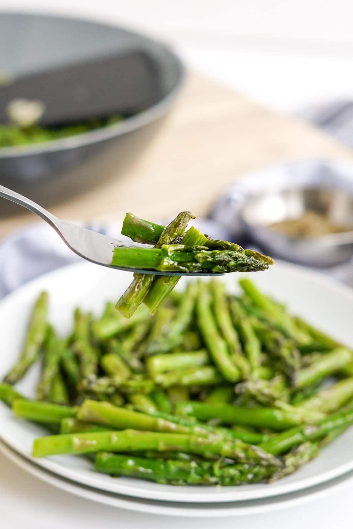 plate of asparagus, fork