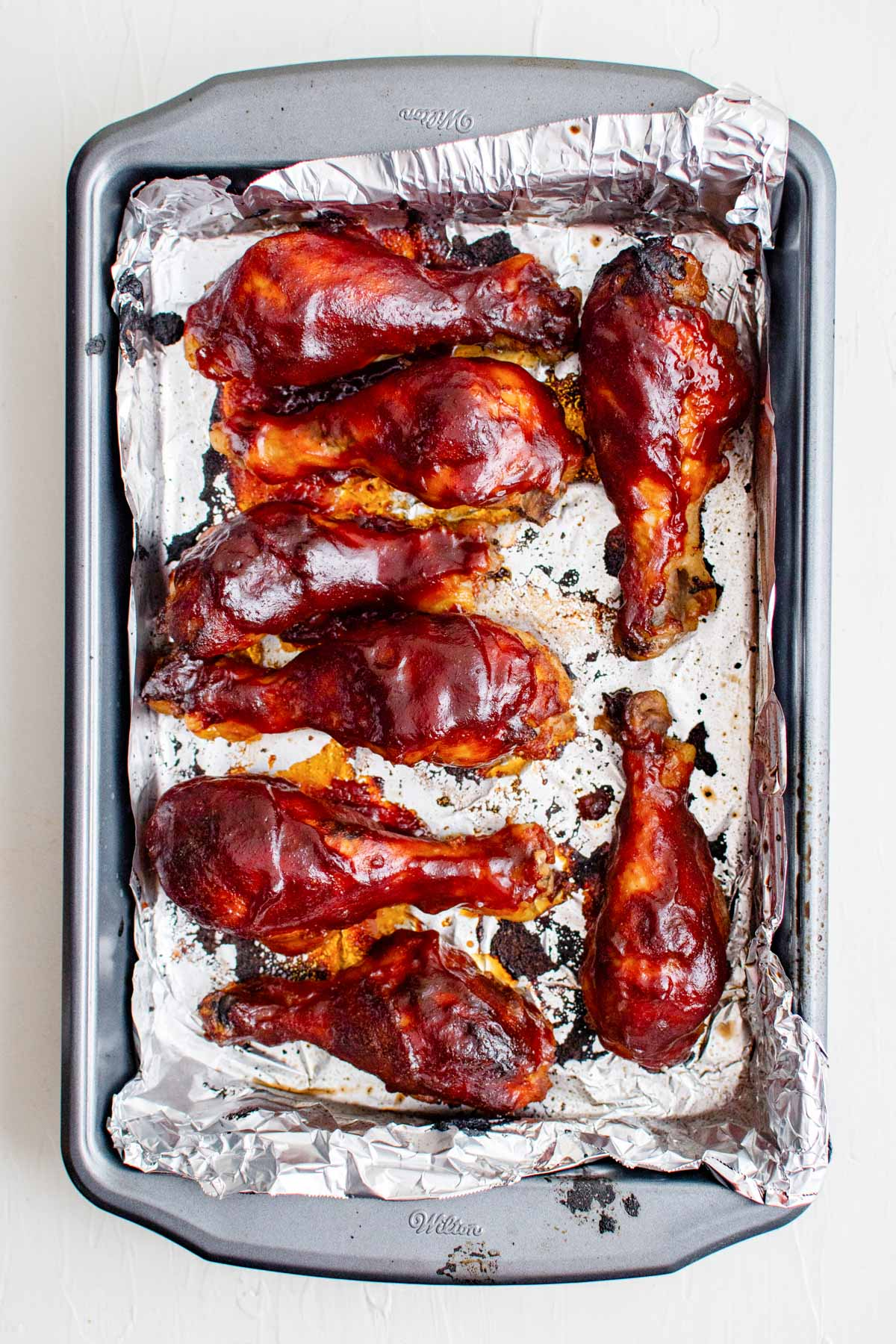 sheet pan with foil, chicken drumsticks with bbq sauce
