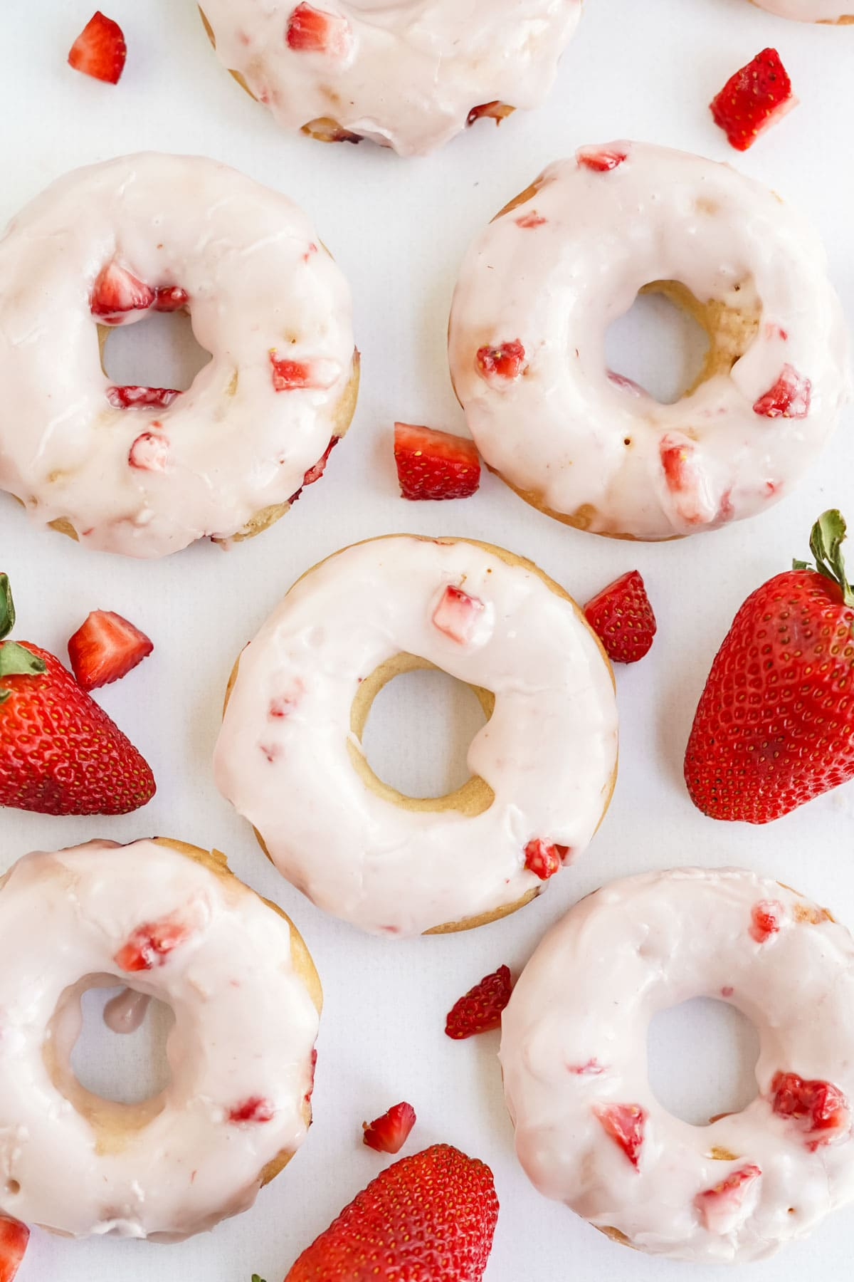 overhead image of strawberry doughnuts with glaze