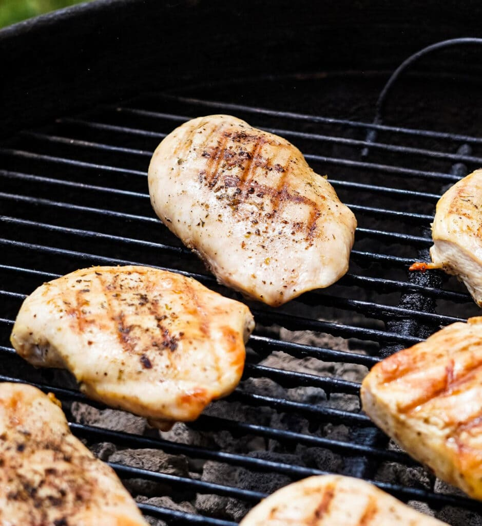 chicken breasts with char marks on a grill