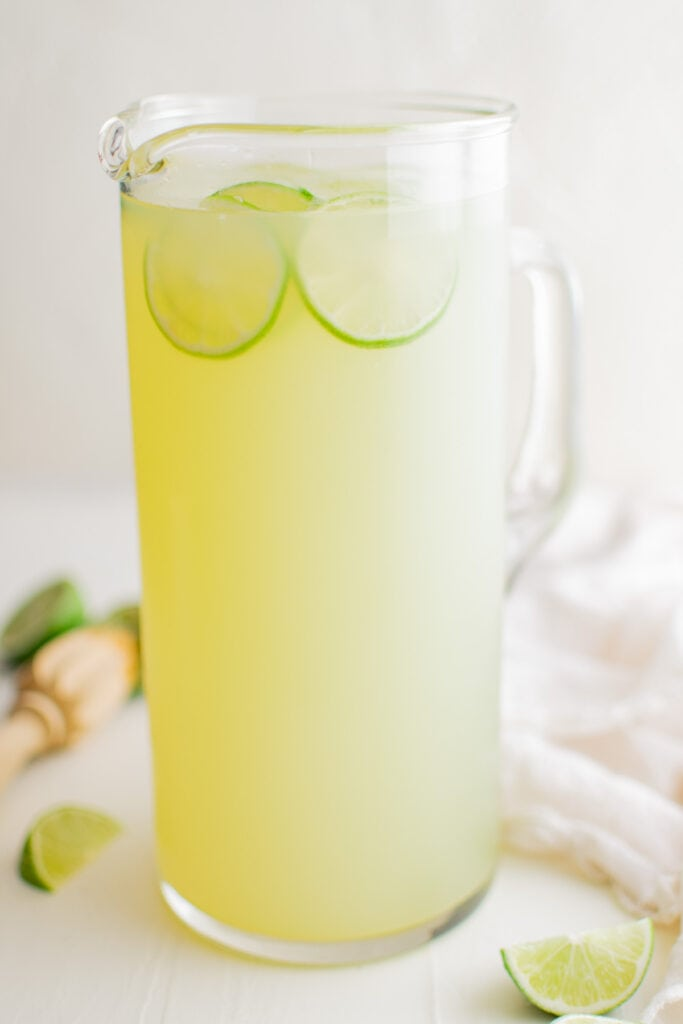 pitcher of limeade with sliced limes