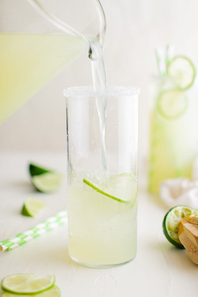 pouring limeade into a glass