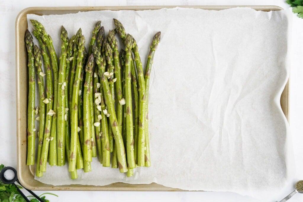 asparagus on a parchment paper lined sheet pan