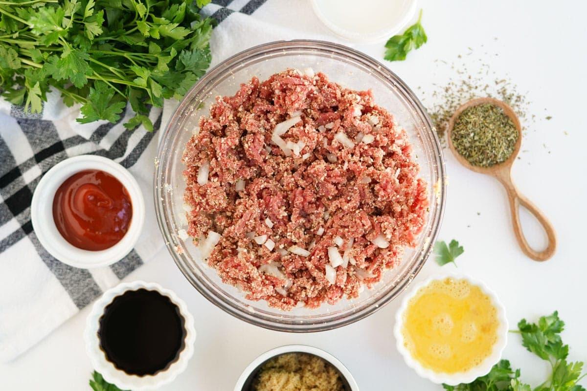 bowl of meatloaf mixture, plus ingredients