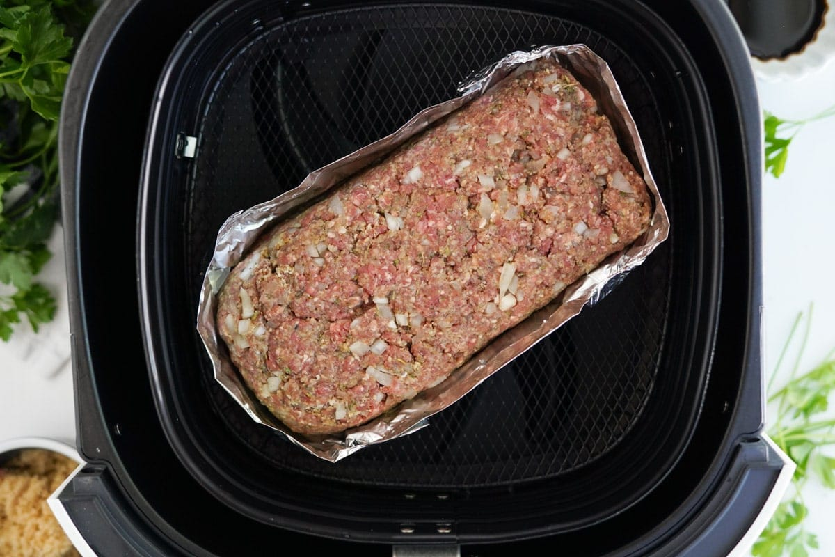 meatloaf wrapped in foil in air fryer basket