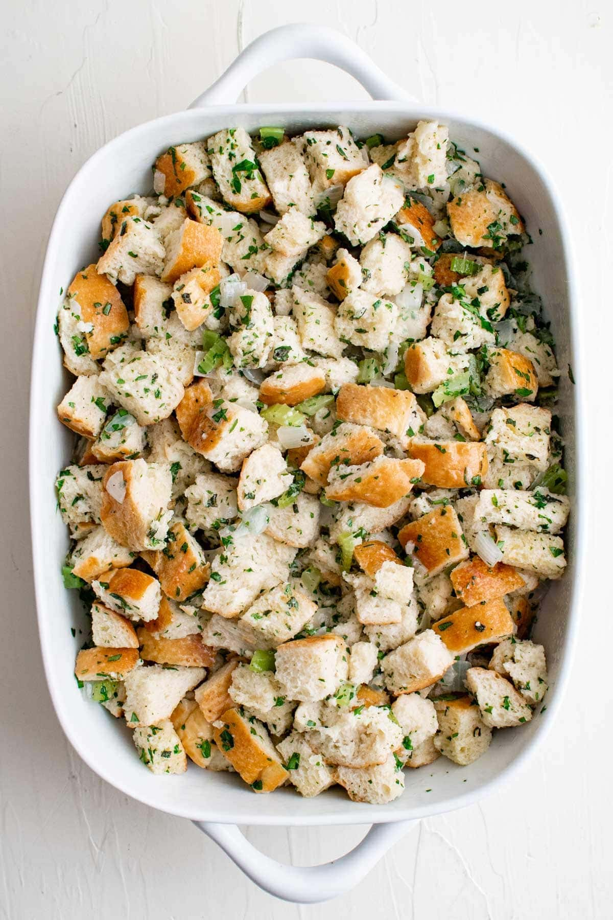 baking dish with unbaked stuffing mixture