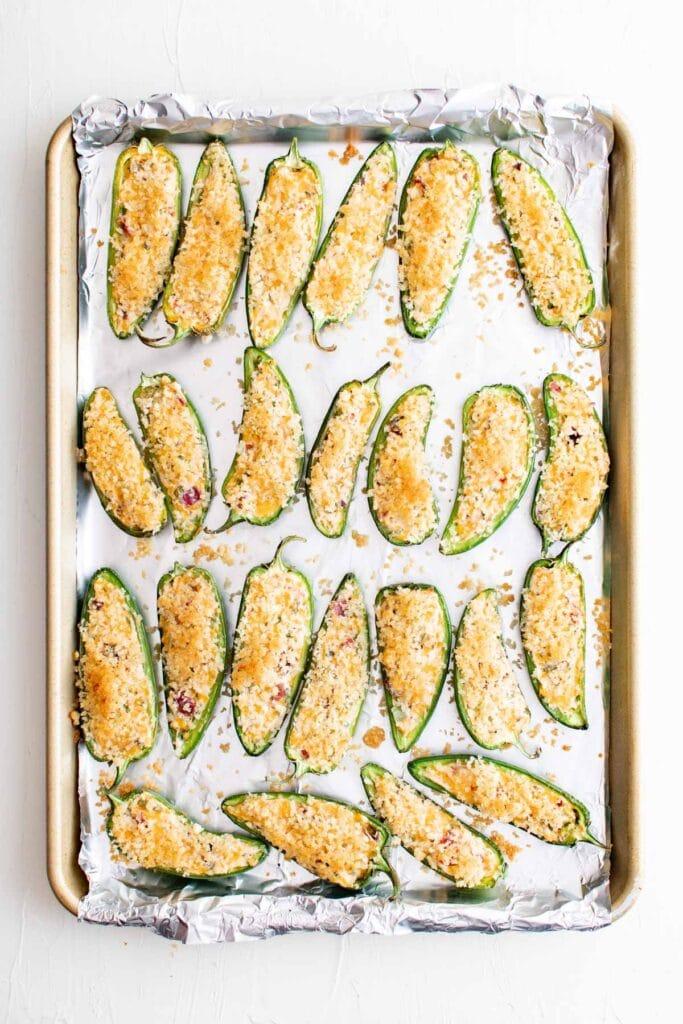 baked jalapeno poppers on baking sheet