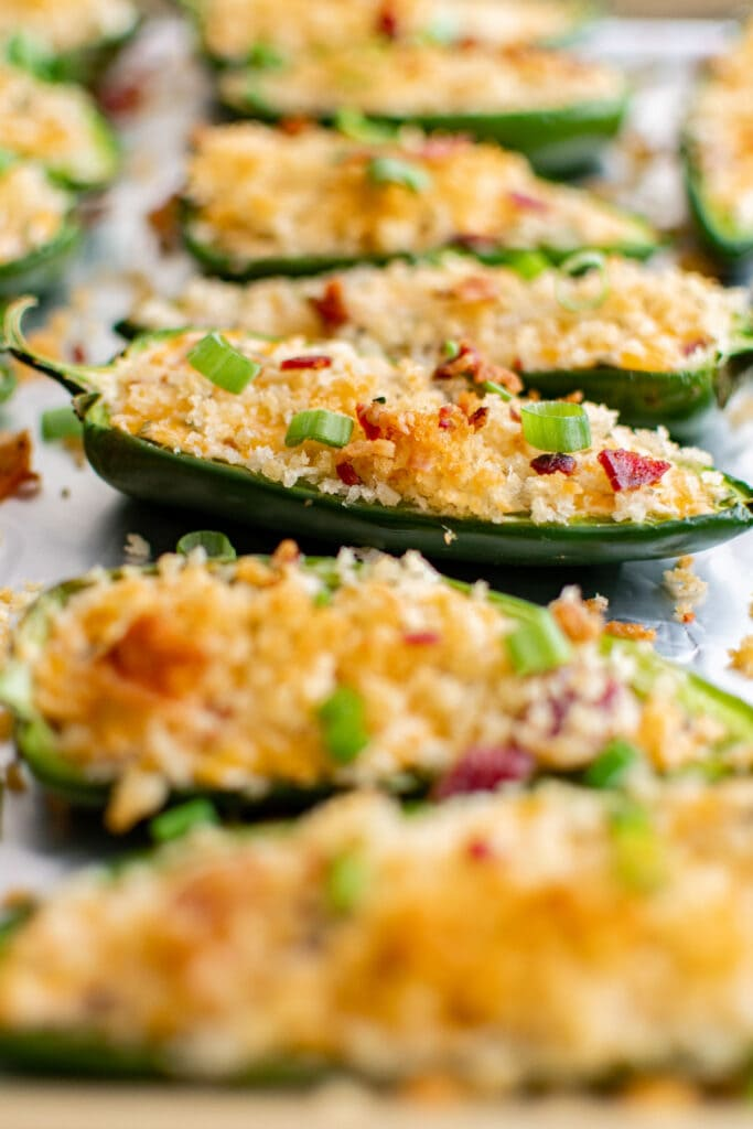 jalapeno halves with breadcrumbs on top and parsley