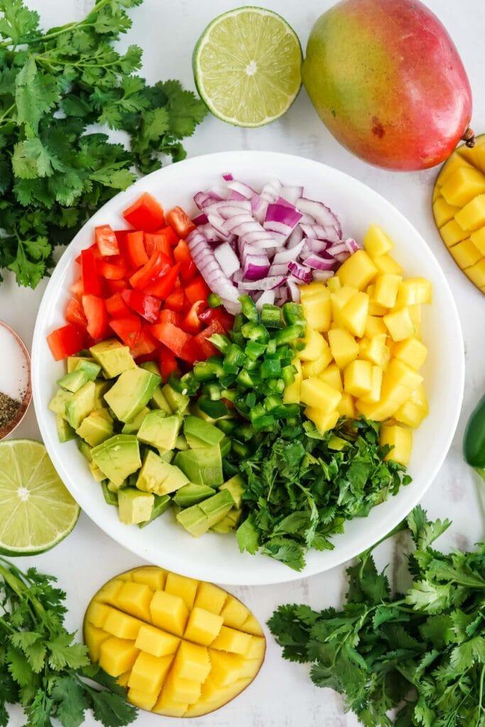 bowl with mango salsa ingredients