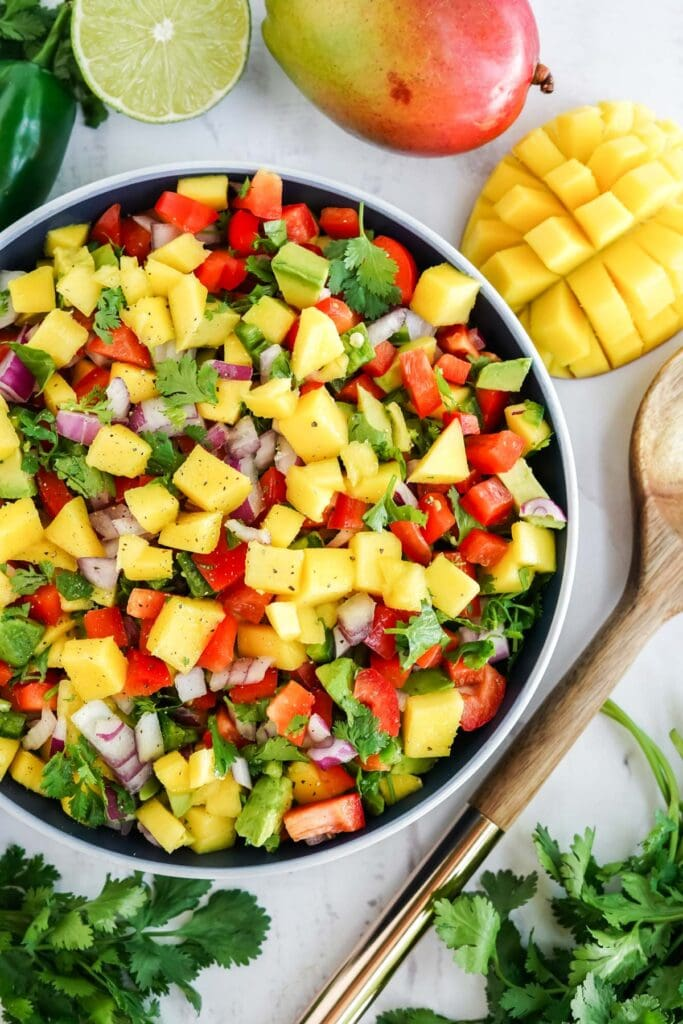 mango salsa in a blue and white bowl