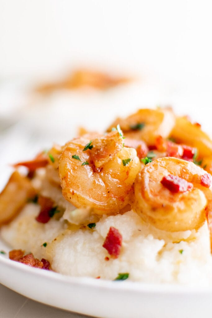 southern style shrimp and grits on a white plate