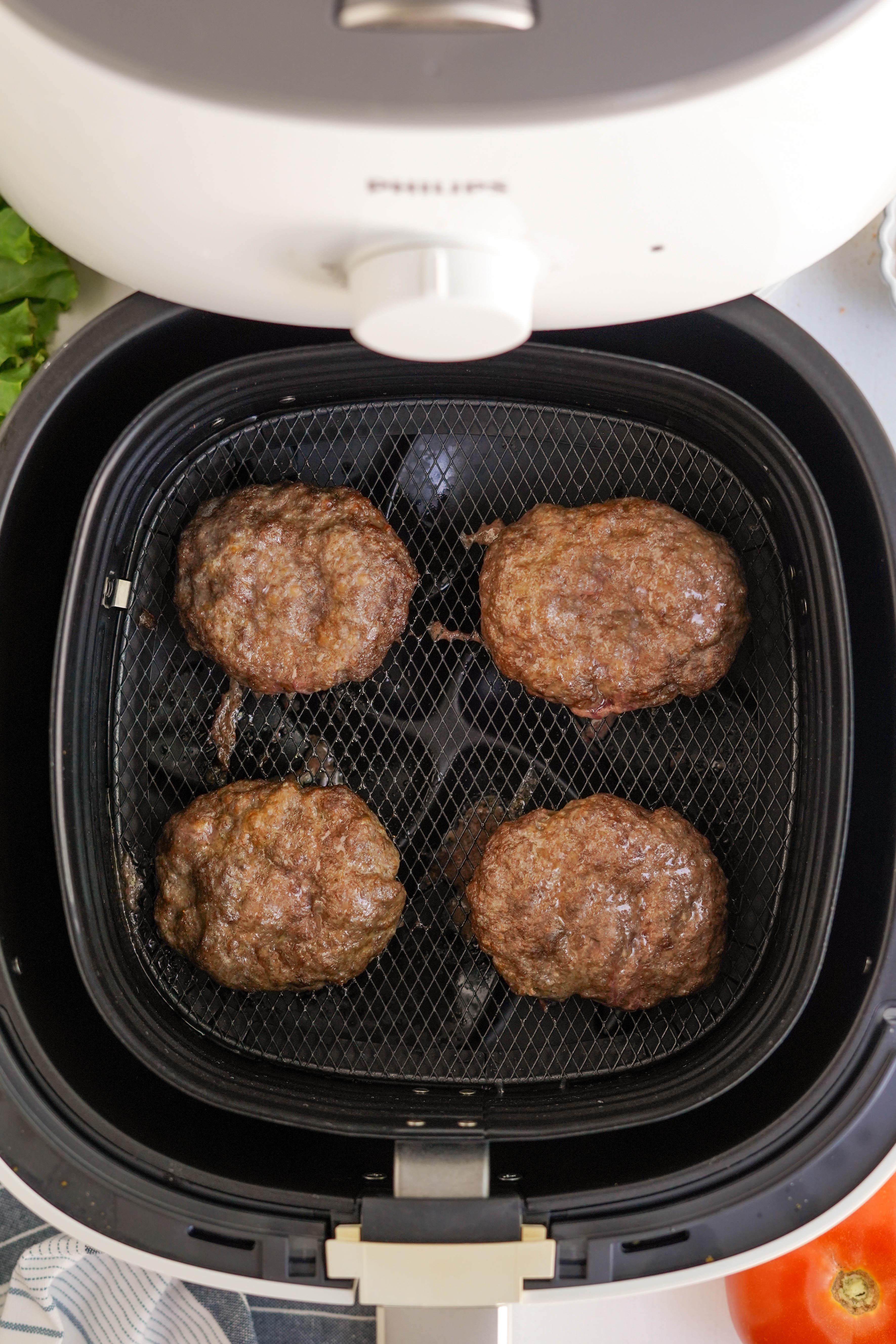 cooked hamburgers in air fryer basket
