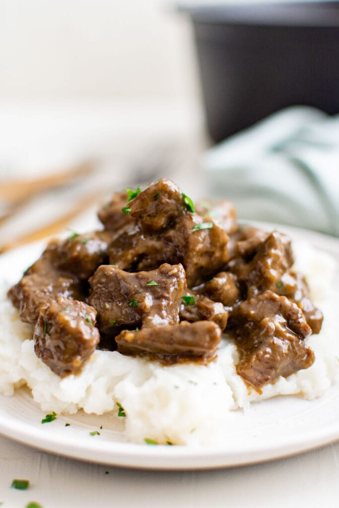 beef tips with gravy over mashed potatoes