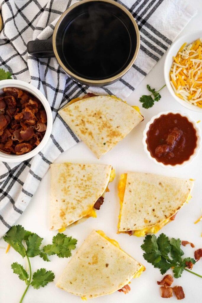 quesadillas, cup of coffee, salsa, bacon