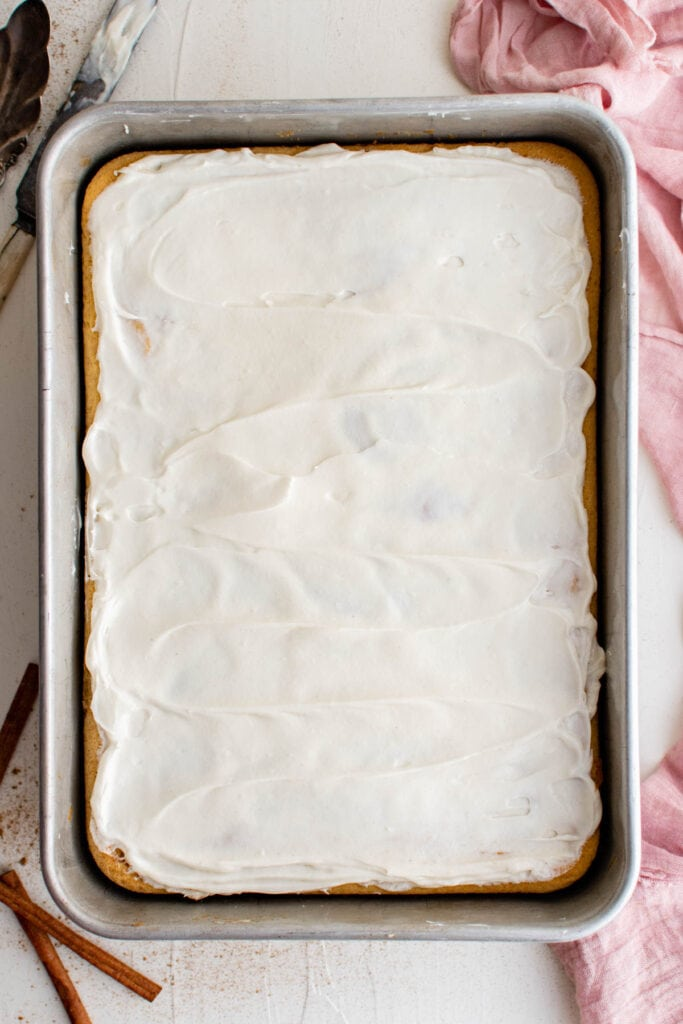 overhead photo of cake with white frosting