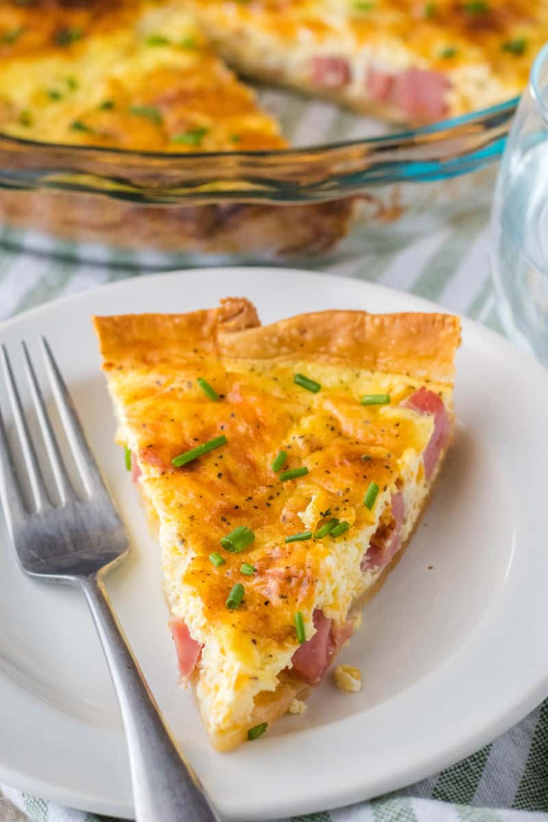 slice of ham quiche on a plate