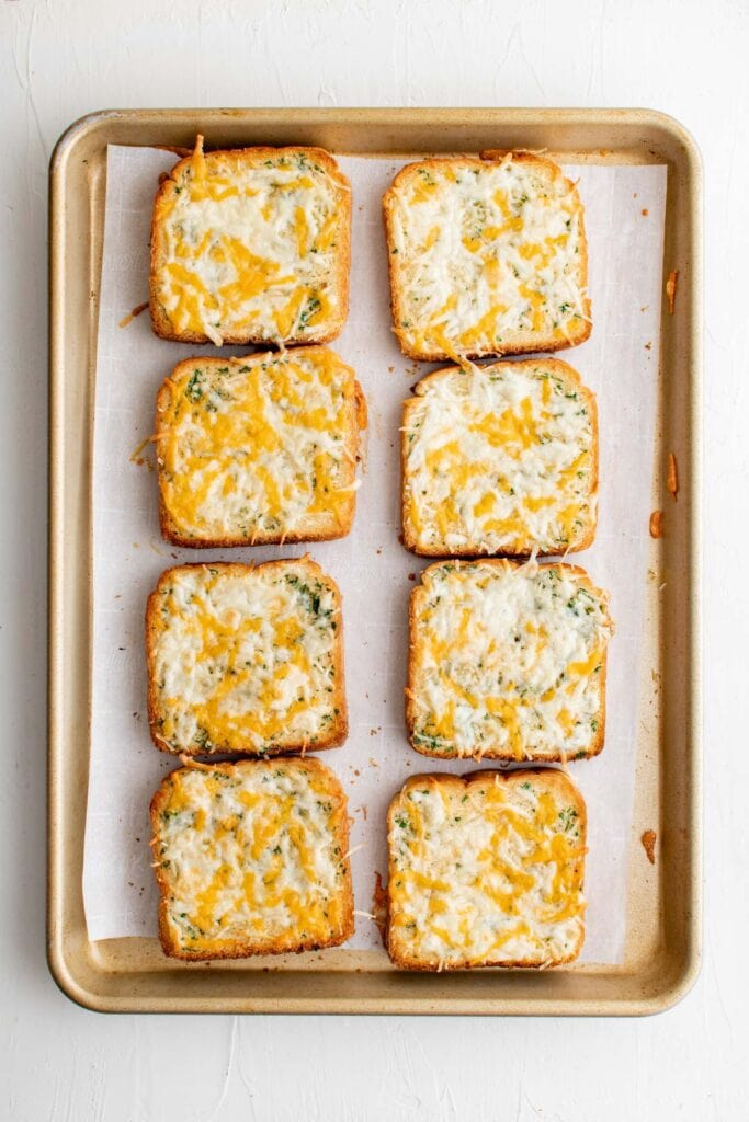 toasted garlic cheese toast on a baking sheet