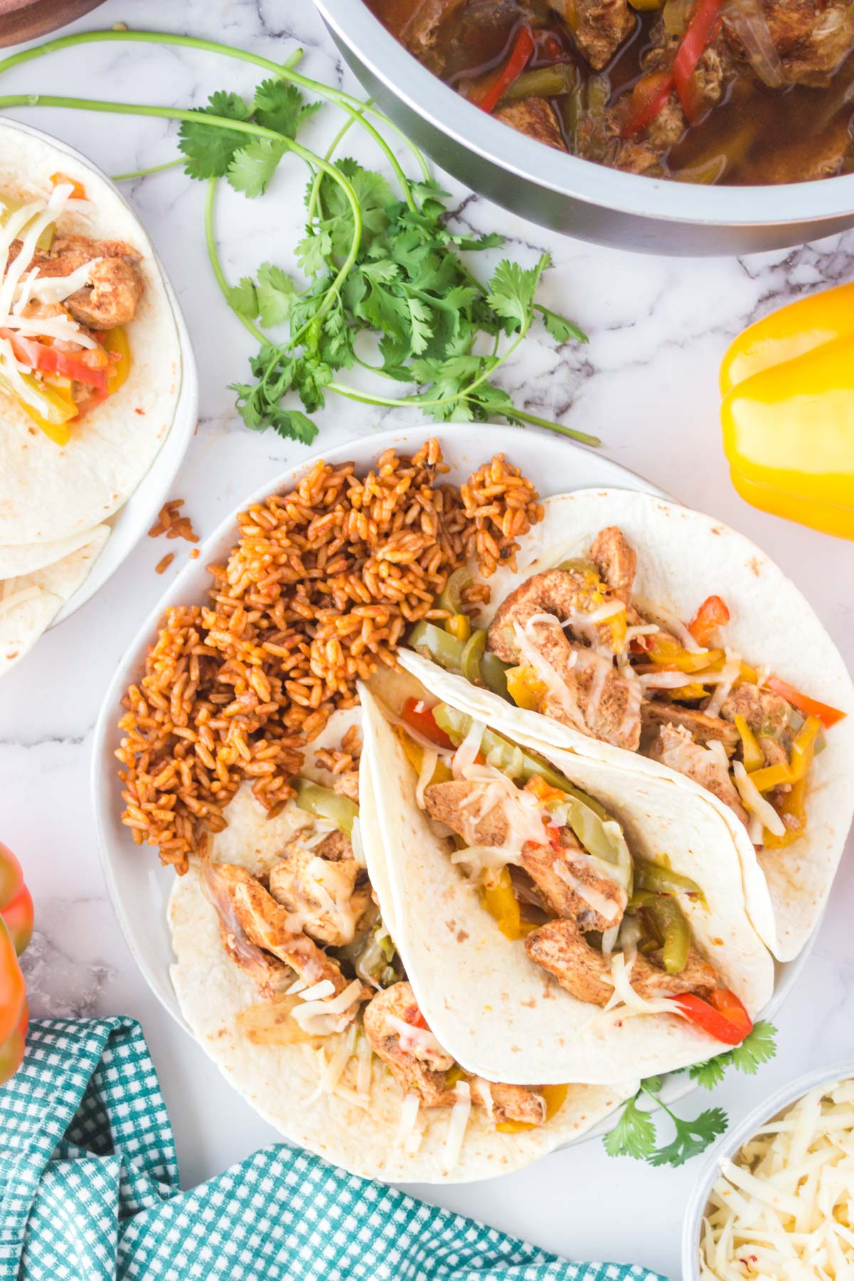 chicken fajitas and rice on a white plate