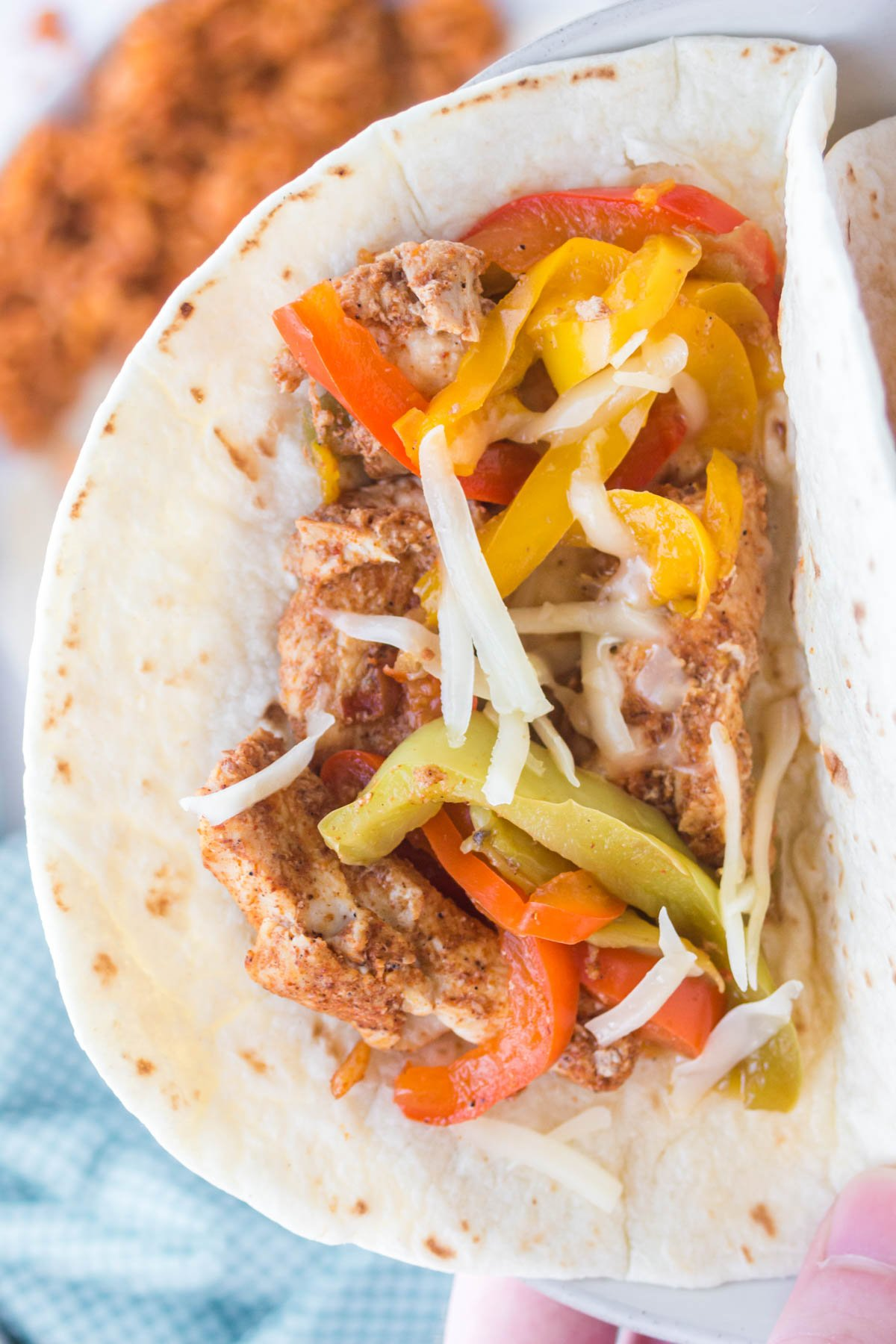 flour tortilla with chicken and bell peppers
