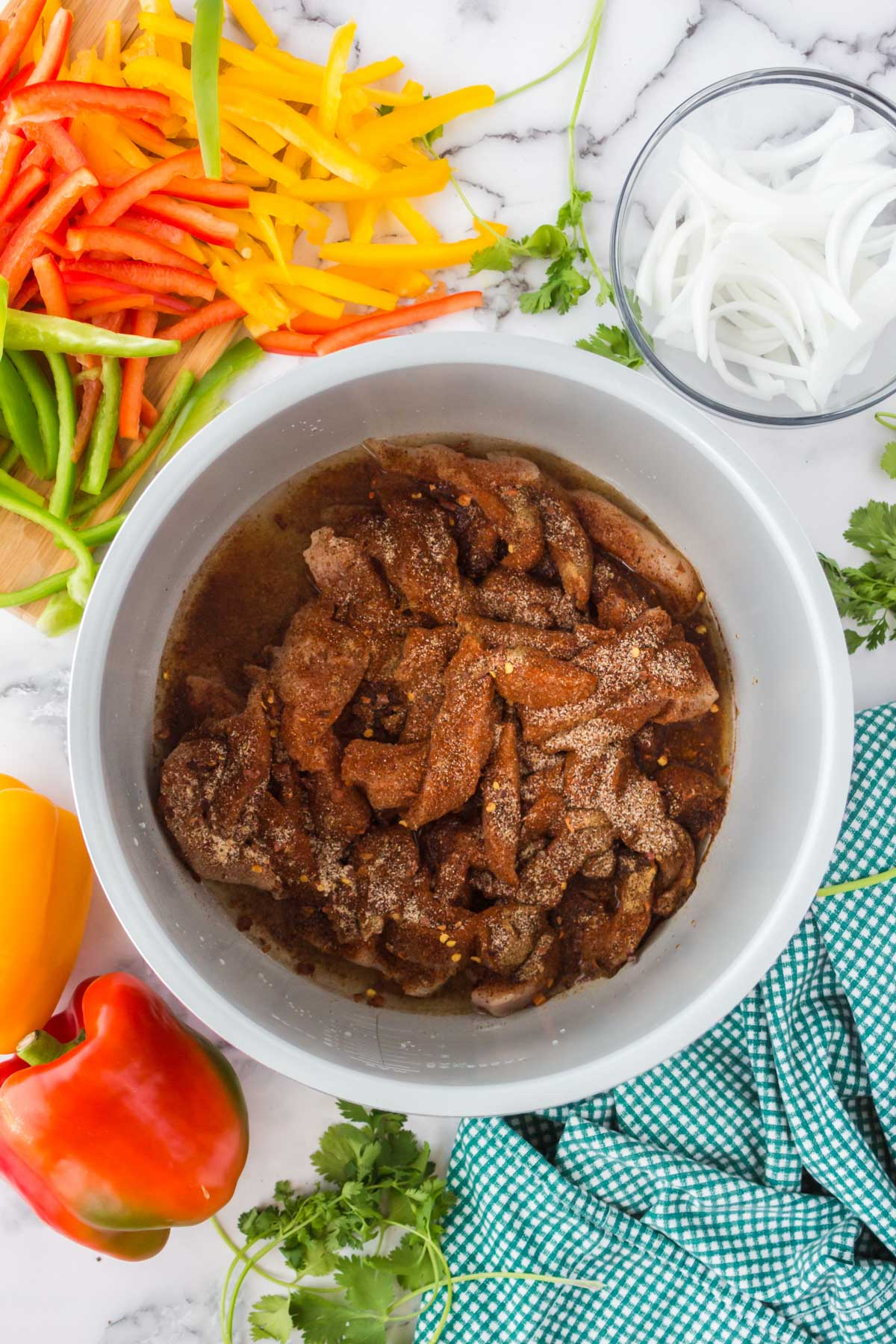chicken and spices in instant pot