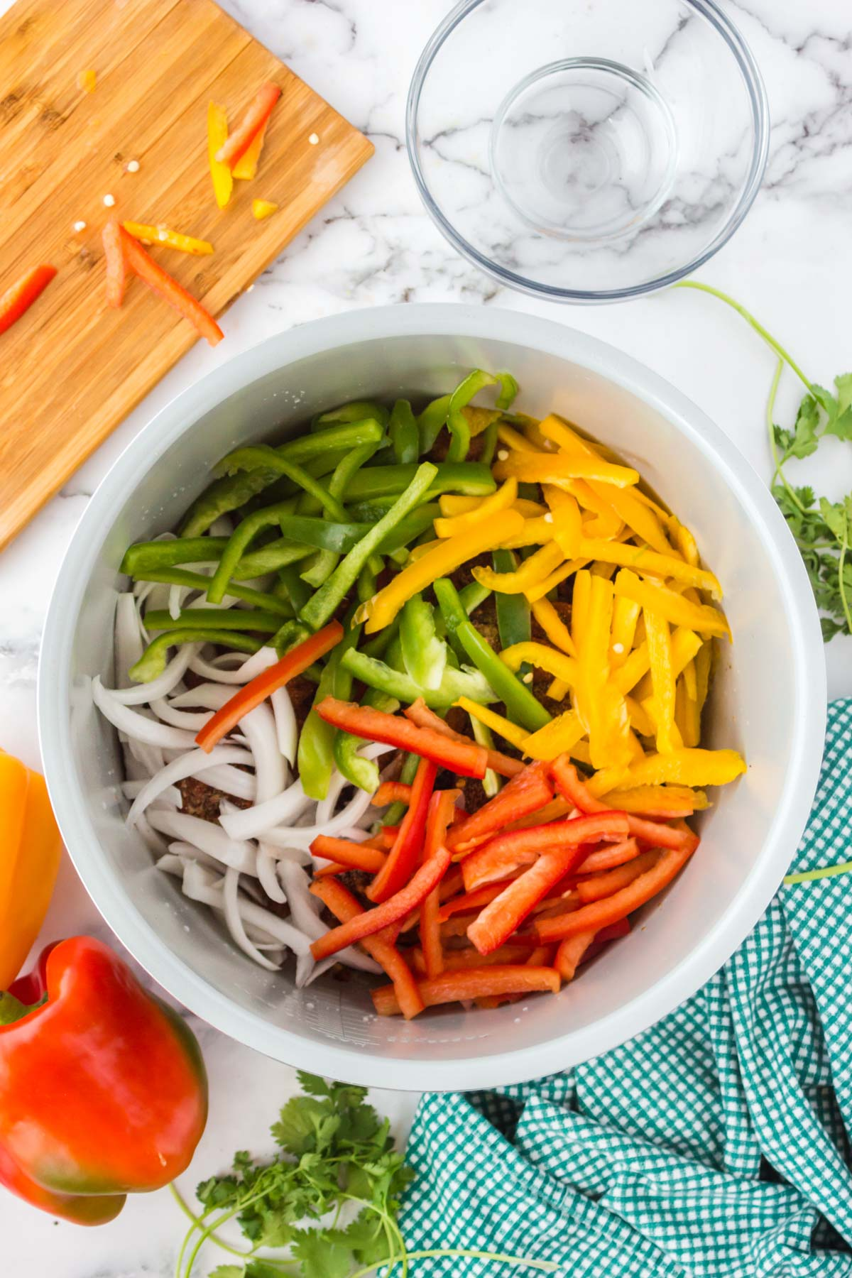 colorful bell peppers and onions in an instant pot
