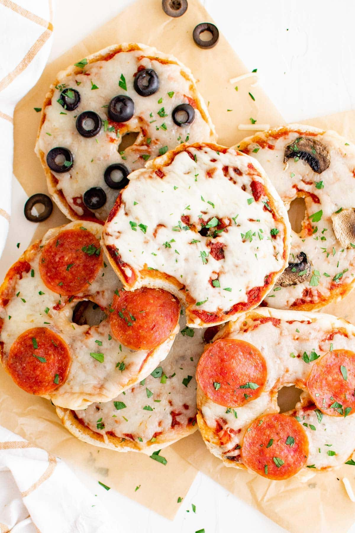 bagels topped with cheese and pizza toppings