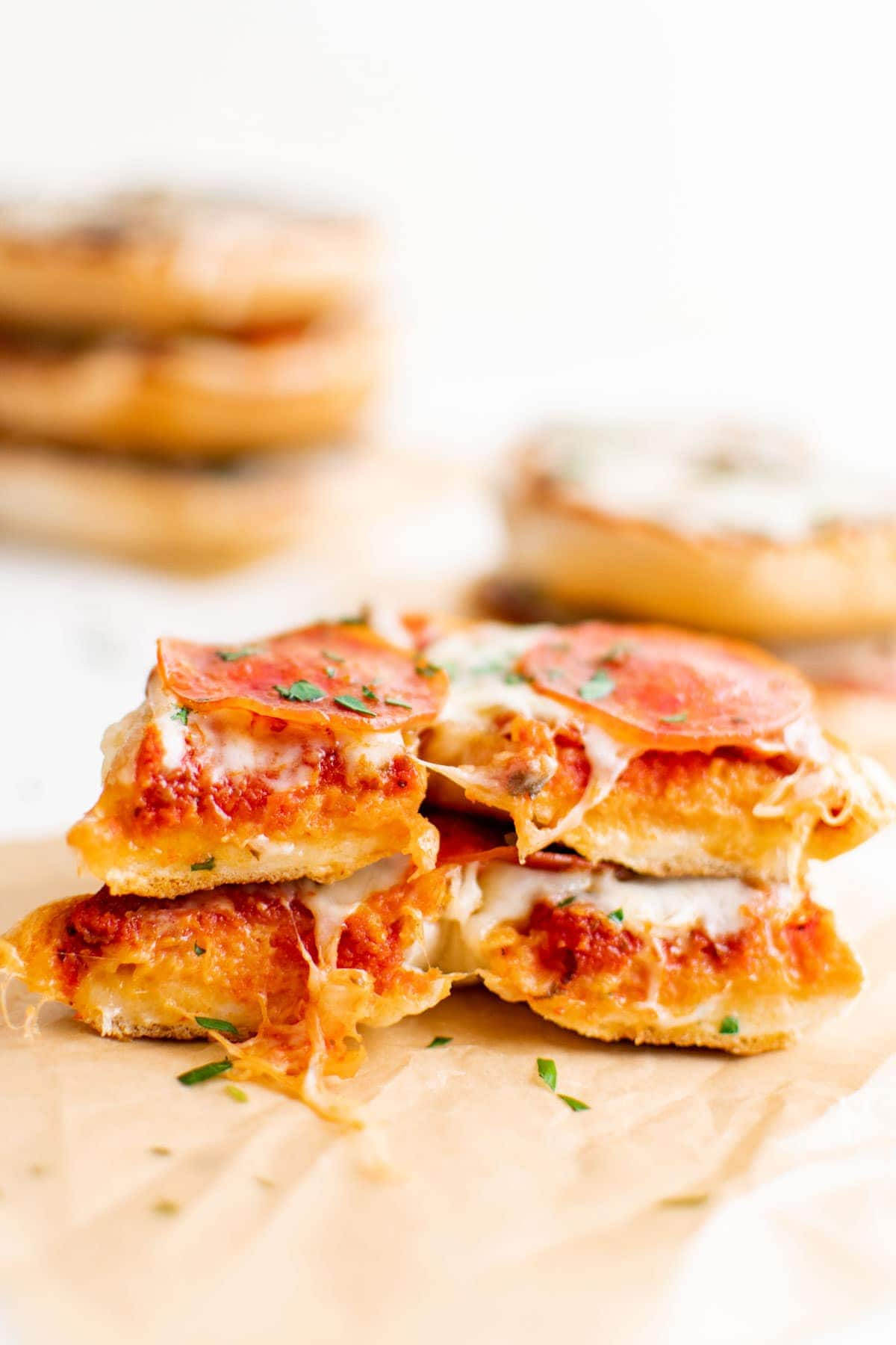 pizza bagel sliced in half and stacked