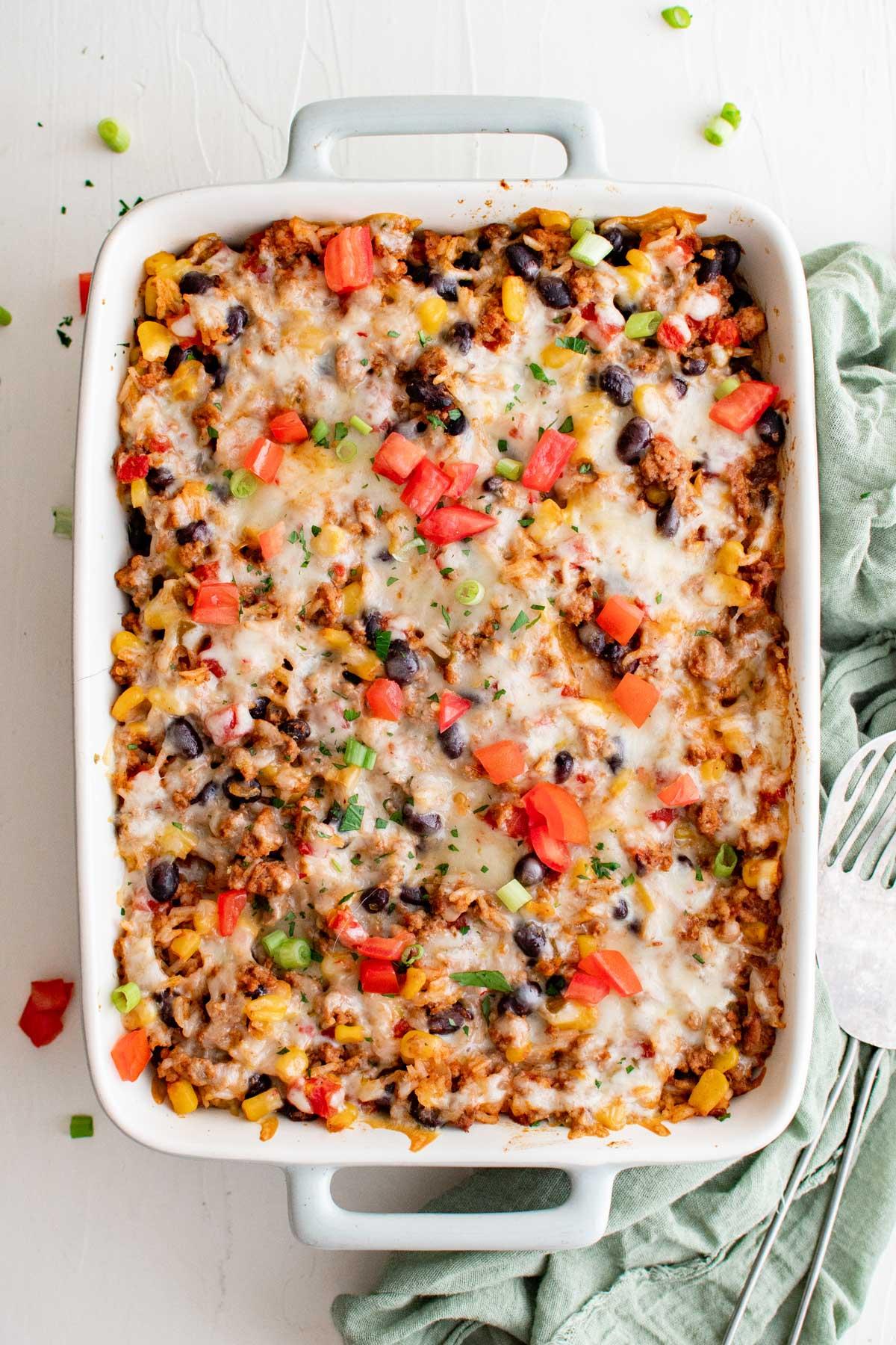 white casserole dish with ground turkey casserole.