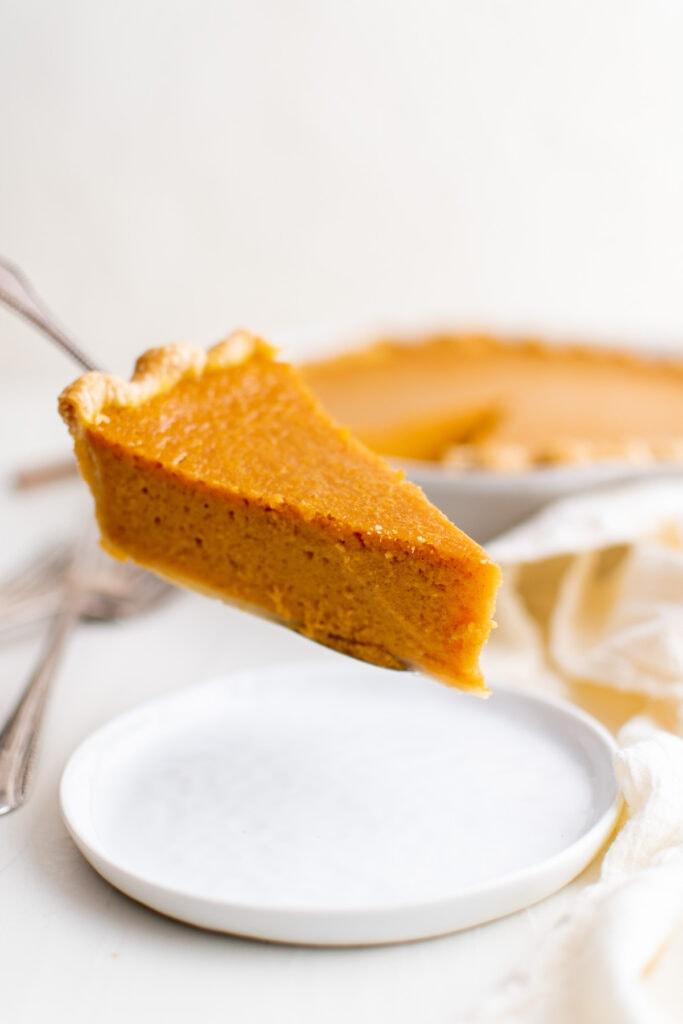 slice of sweet potato pie on a serving spoon