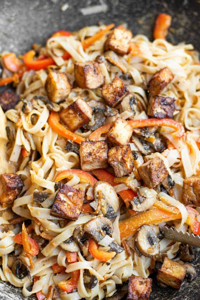 carrots, mushrooms and tofu in a skillet