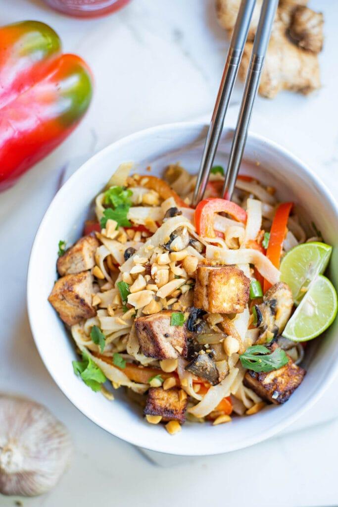 bowl of pas thai with chopsticks
