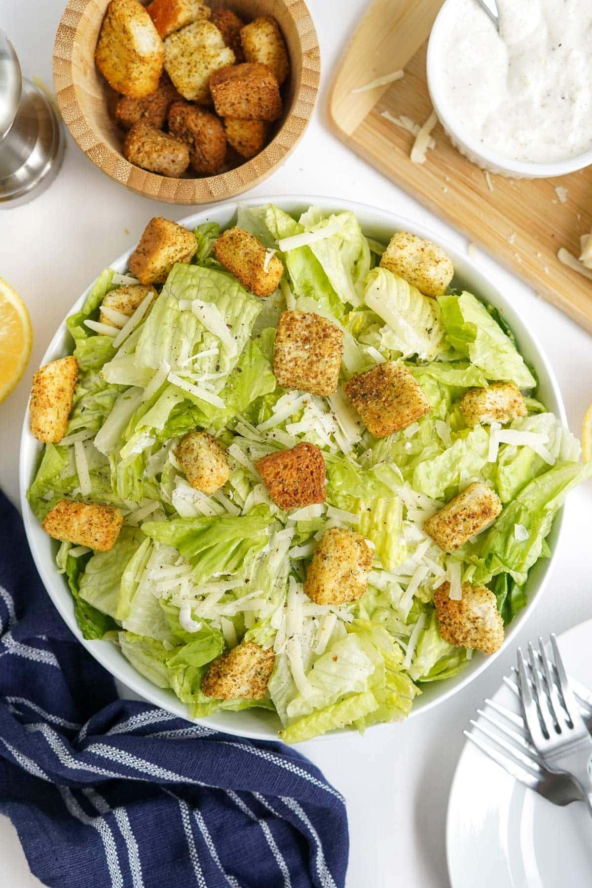caesar salad in a white bowl