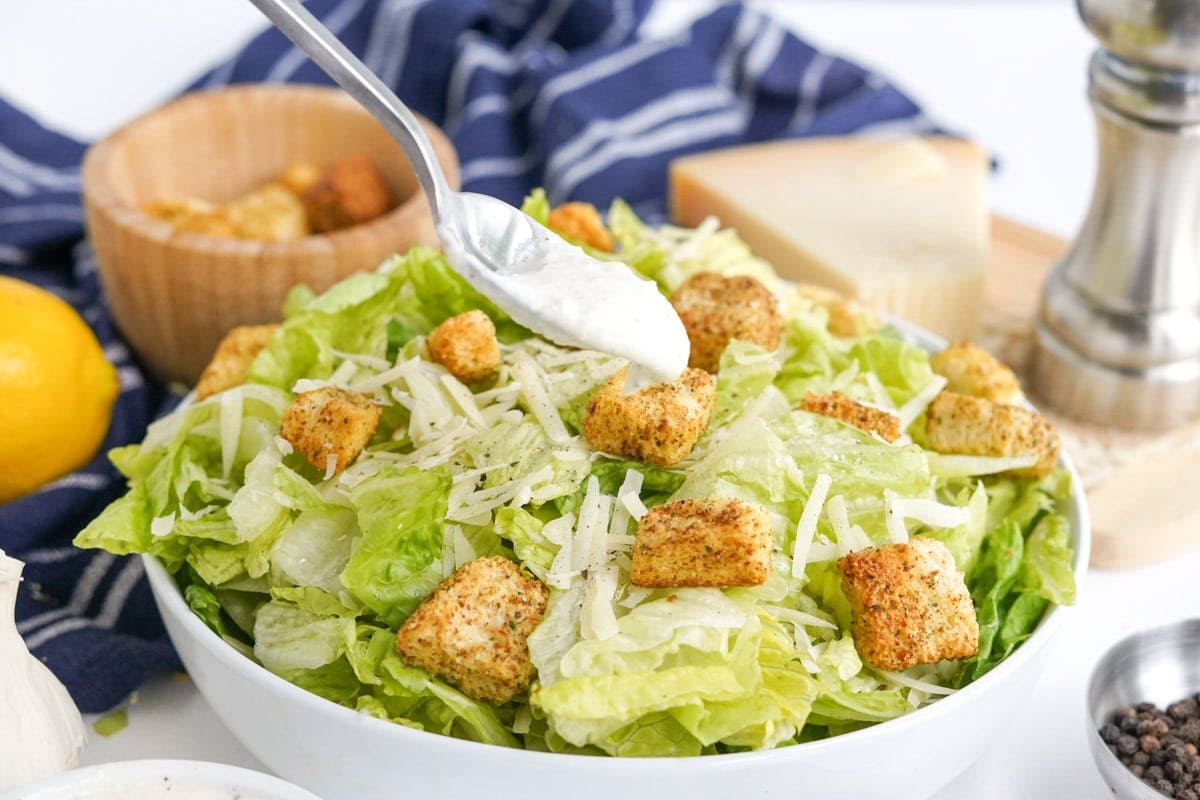 salad with croutons, spoon with dressing
