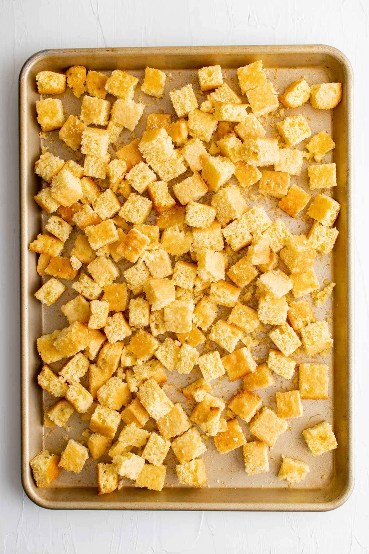 cubes of cornbread on a baking sheet