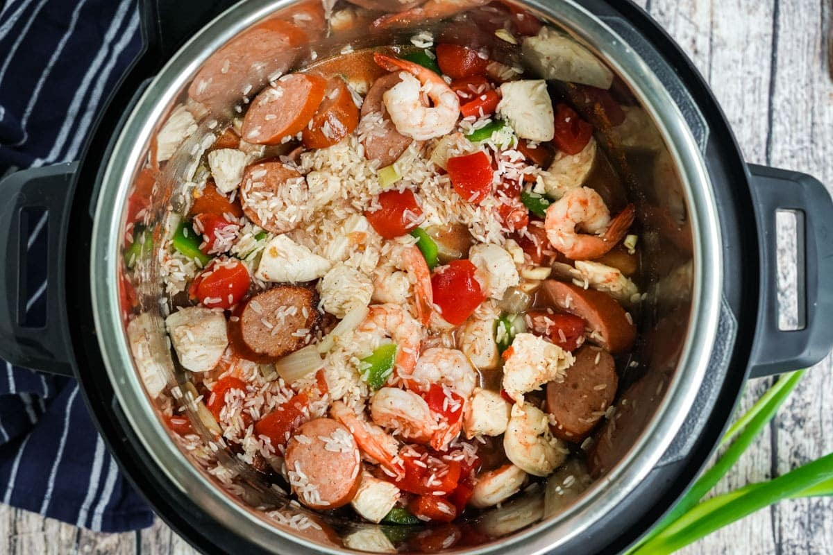 rice, sausage, shrimp , chicken and vegetables in instant pot