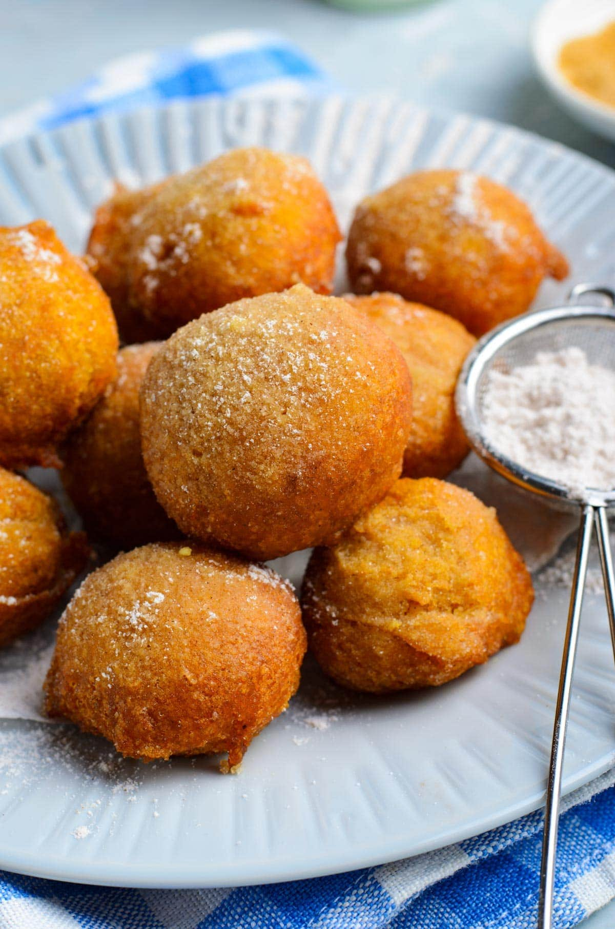 fritters made from pumpkin on a white plate