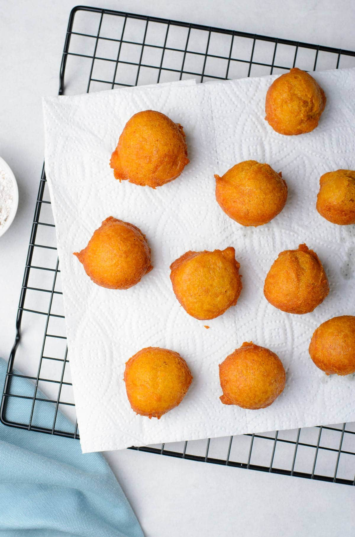 fritters on a paper towel and wire rack