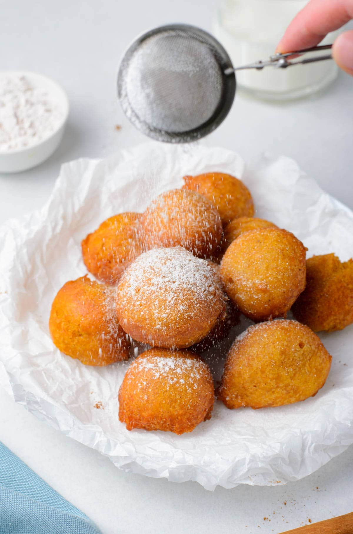 powdered sugar shaker over the fritters