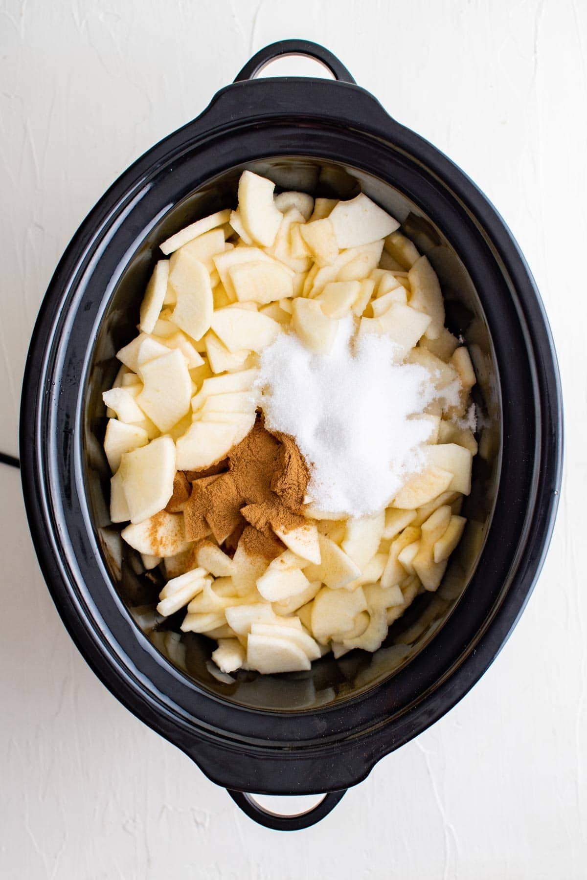 apples, cinnamon and sugar in a crock pot