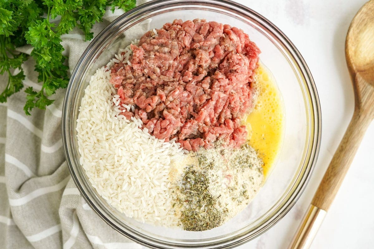 ground beef, rice, egg and seasonings in a large bowl
