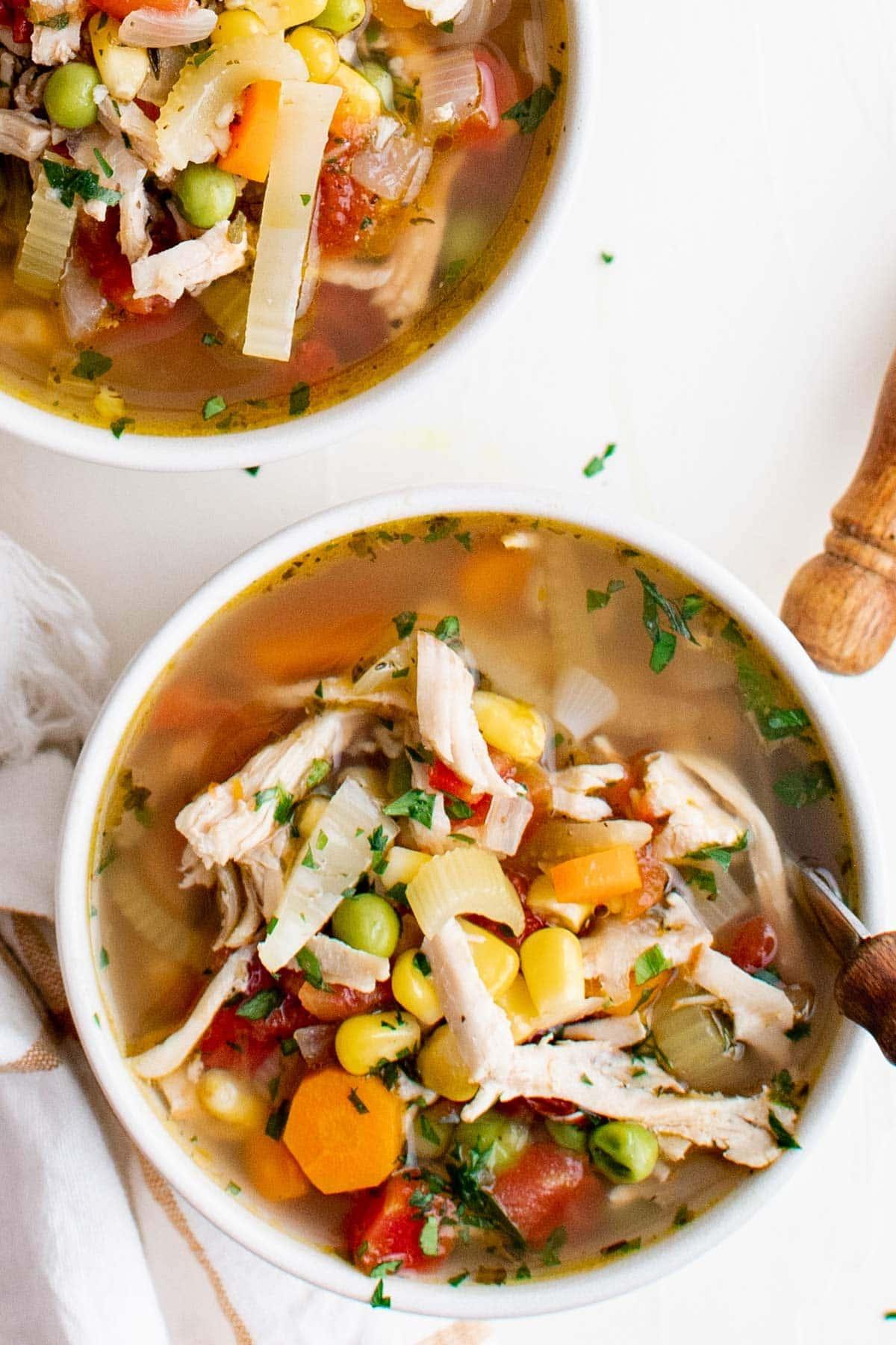 turkey soup in a white bowl
