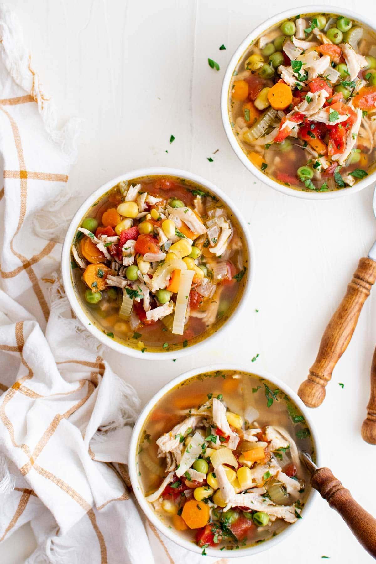 turkey veggie soup in white bowls